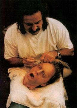 Tom Savini punching hair into the gelatin Brad Dourif head from Dario Argento's Trauma