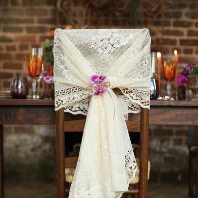 Try a lace curtain panel or even a small tablecloth for an inexpensive alternative for the bride's table.