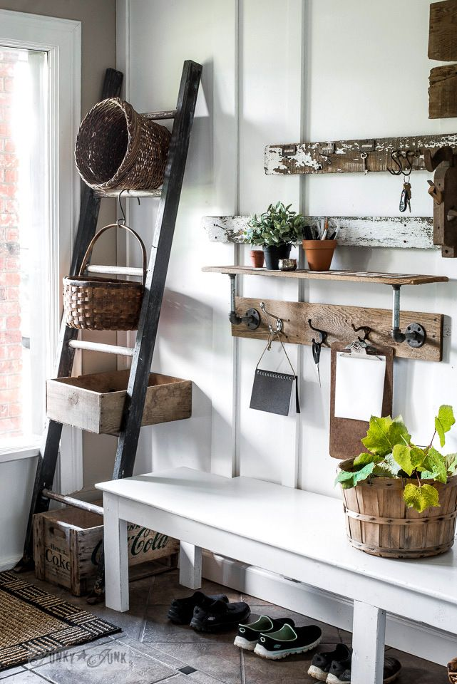 Front entry ladder basket and crate storage, with reclaimed wood pipe shelf | funkyjunkinteriors.net