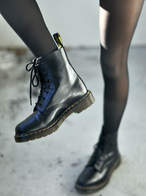 combat boots. doc martens are great but any plain black or dark brown pair would be fine