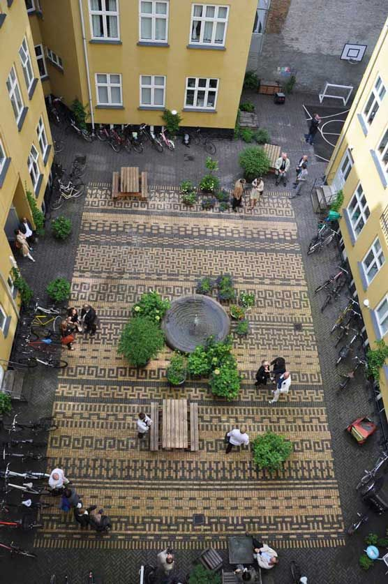 Improving the quality of urban environment enhancing our courtyards -- A well-designed pavement changes the perception of the environment, and enhances the semi-public space, which is always at risk of becoming a degraded and unhealthy part of the urban environment. --Courtyard 1:1 landskab Classensgade