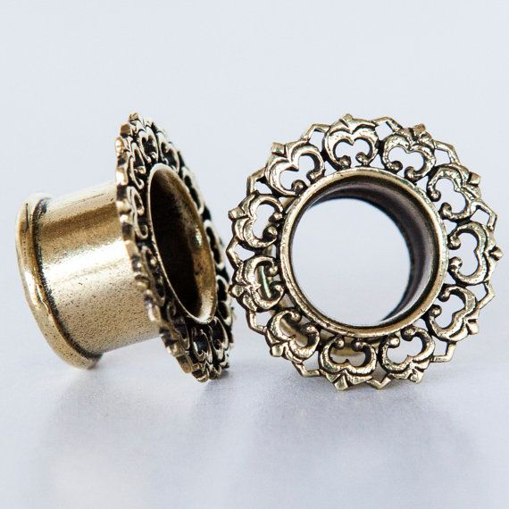 New in my brass antique look collection. a brass tunnel nickel free .    Will look grate with a brass earring going through the tunnel .    Dont forget
