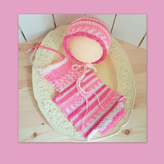 Dainty little knitted baby romper and matching bonnet in pink  Soft baby romper with halter neck ties. The bonnet has a scalloped edge to frame babys face.  Perfect for babys first photo shoot  Please never leave a baby unattended in a bonnet  Made from easy wash acrylic yarn