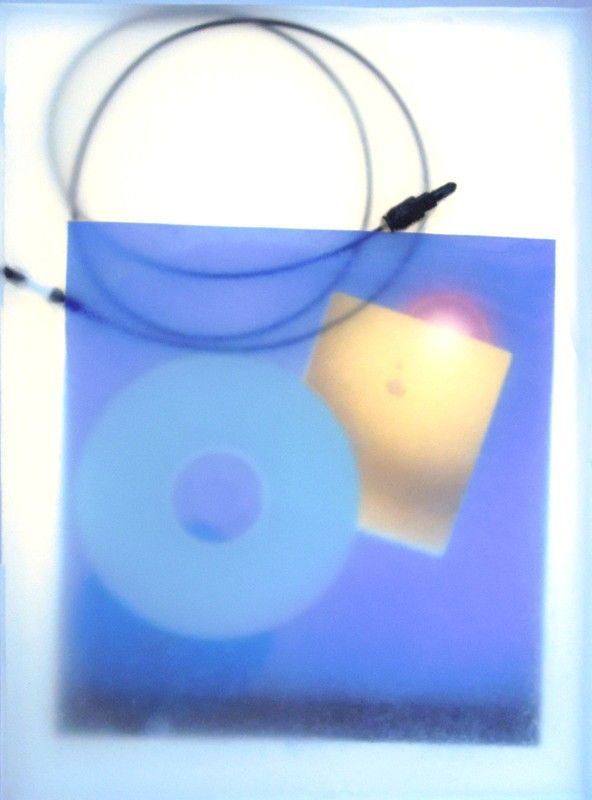 "Katie Torn by Marisa Olson 2014 Caroline Delieutraz by Marisa Olson 2014 Previous Image Next Image Return to Article Les Oracles 12 / 16 Caroline Delieutraz, ""Embedded Files"", Blocks of paraffin, desk (glass, trestles), lights, 2014"