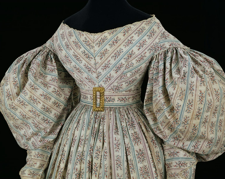 1830-1834 Sleeves of this size had to be supported as they were often made of flimsy fabric. Some styles had stiff buckram undersleeves or hoops to give them their shape. The sleeves shown here are unlined, so the wearer probably attached a large down-filled pad to each arm just below the shoulder line to distend them. Feathers can be easily compressed so the pad could be squeezed through the narrow armhole of the dress.