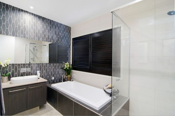 I like the style of the feature wall in this Metricon Bathroom - Cedar