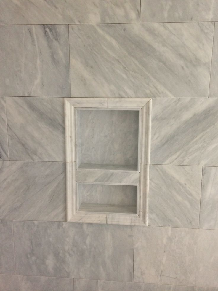 Carrara marble at Master shower walls with niche framed in ...