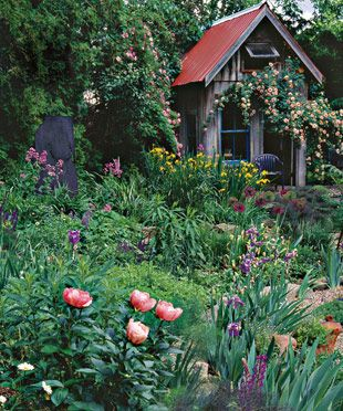 Cottage Style Garden:  Although this cottage garden looks casual, it relies on several elements that provide a sense of structure. For example, a garden house serves as a focal point and a backdrop for growing roses.