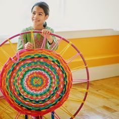 Turn Old T-shirts Into an Accent Rug using a hula hoop. Brilliant! I've dreading braiding or making a frame to make a loom but this is great!