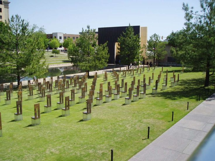 The Oklahoma City National Memorial The Outdoor Symbolic Memorial is a 3.3 acre site in Oklahoma City. It encompasses what once was Fifth Street, the former Journal Record Newspaper Building and land located north of the bombed building. From the Gates of Time, the symbolic elements include a Field of Empty Chairs, A Reflecting Pool, the Survivor Tree, the Rescuers' Orchard, the Survivor Wall, a Children's Area and the fence that originally protected the crime scene,
