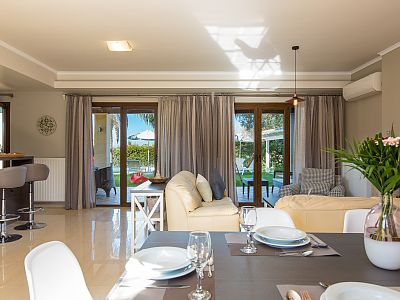 Rethymno villa rental - Direct access to the pool terrace from the living room area!