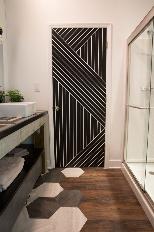 Geometric Bathroom Door with painter's tape.  Paint a pattern.  Modern Bathroom Makeover
