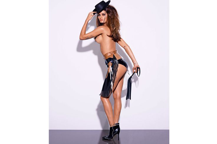 Brazilian model Isabeli Fontana, who appeared in last year's 50th anniversary calendar, wore a barely-there outfit, in a cow-girl style, completed with a fringed apron over black PVC underwear. Description from dailybraille.co.uk. I searched for this on bing.com/images