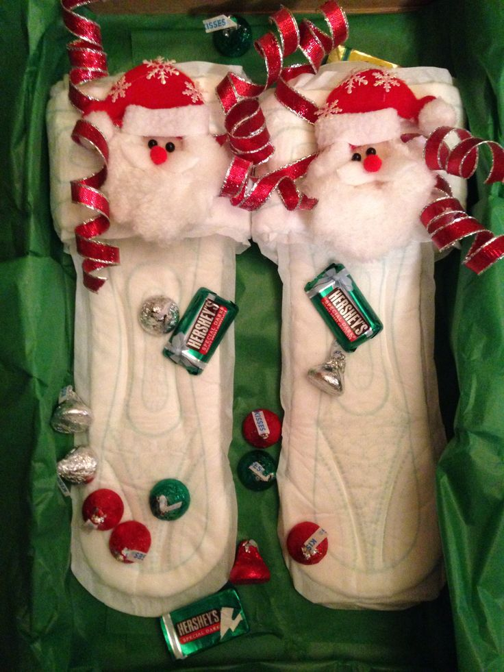 "Maxi pad slippers for a white elephant gift exchange.   ""Chocolates and PMS go hand in hand. Only women will understand! These slippers are discreet and special for your feet so eat some chocolate it's quite a treat!!"""