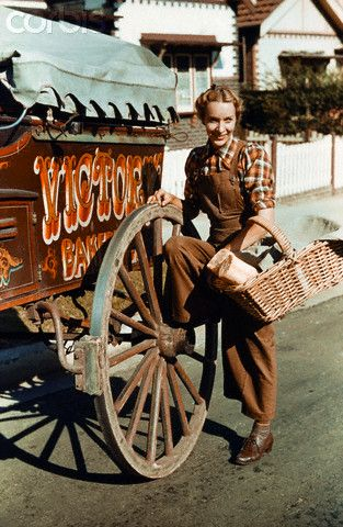 A young woman delivers bread using a cart. Sydney, Australia. 1943.