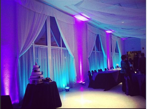 Wedding at Lakeside Reception Hall with teal and purple uplighting to accent the brides peacock theme wedding by Our DJ Rocks