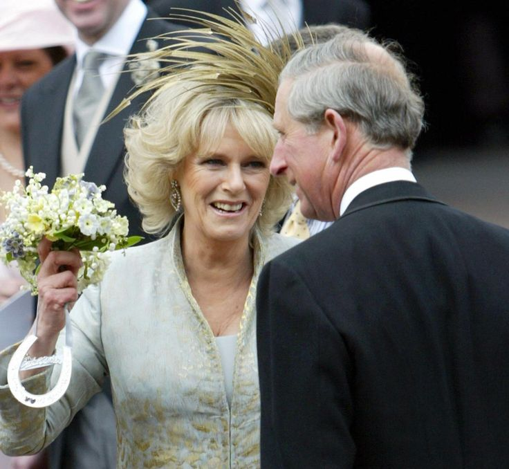 Prince Charles and the Duchess of Cornwall, formerly Camilla Parker Bowles, greet well wishers outside St. George's Chapel. Alastair Grant, AFP/Getty Images.