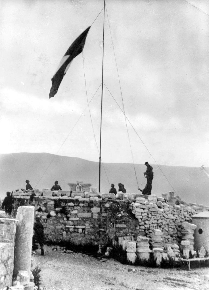 German soldiers raising the flag in Crete after the conquest in May 1941.