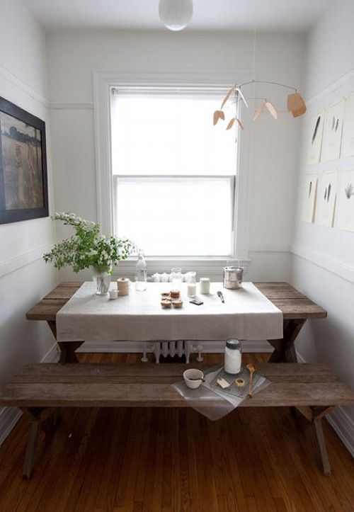 Loving... this has always made me smile... a simple, rustic picnic table as a dining area in a small space... how clever!