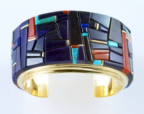 Cuff | Charles Loloma (Hopi Pueblo).  Gold, sugilite, coral, turquoise and lapis.
