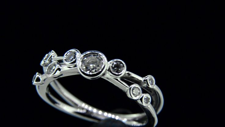 'DIXIE' -- Pretty 18ct White Gold Diamond Kiss Engagement Ring Bezel set with Scattered Brilliant Cut Diamonds Diamond Wt. 0.44ct.
