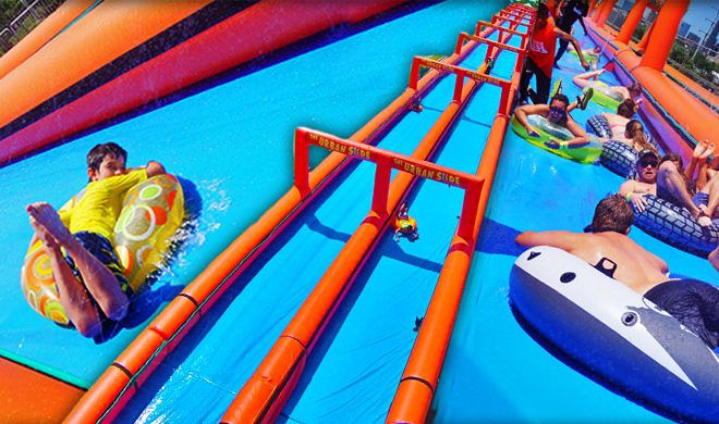 Slide Through Downtown Marble Falls On A Massive Water Slide Water Slides Marble Falls Best Family Vacations