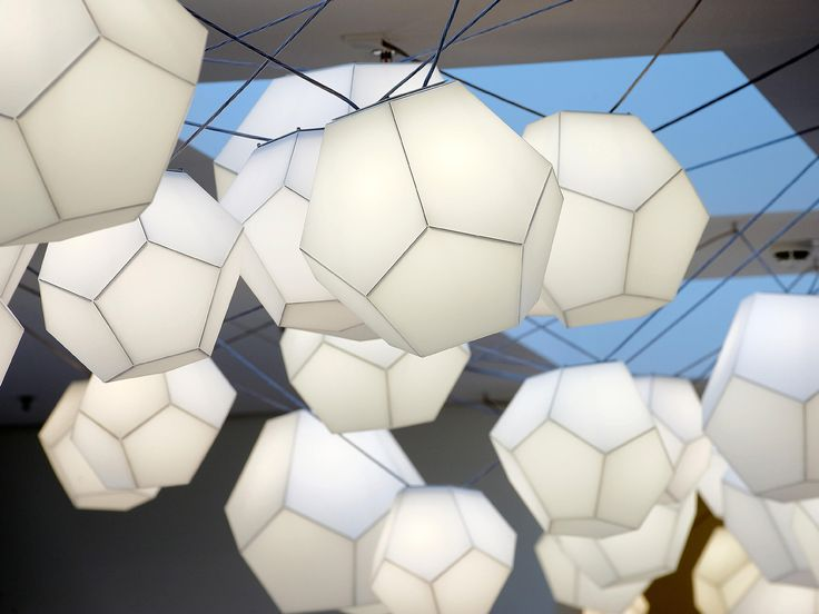 Twelve pentagons create a dodecahedron. Manufactured from light polycarbonate, the dodecahedron becomes a lamp. The illuminant fills the room with a mild,..