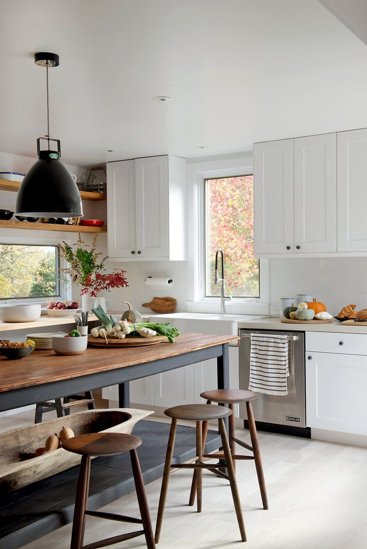 Rustic wooden island in a white kitchen