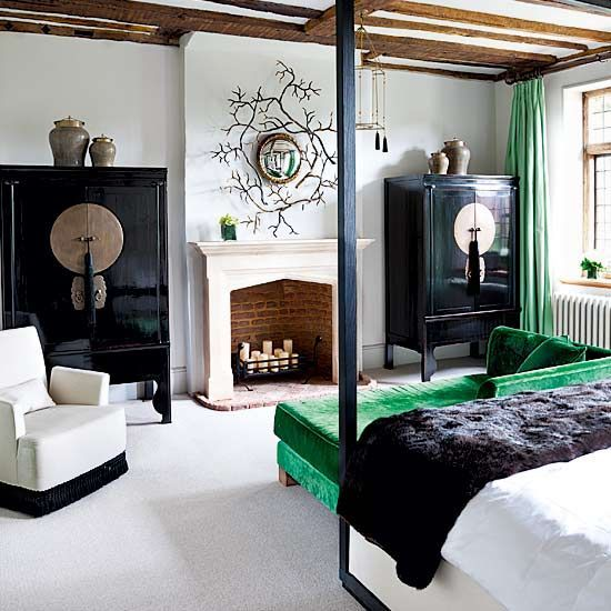 polished black cabinets and emerald textiles to spruce the bedroom