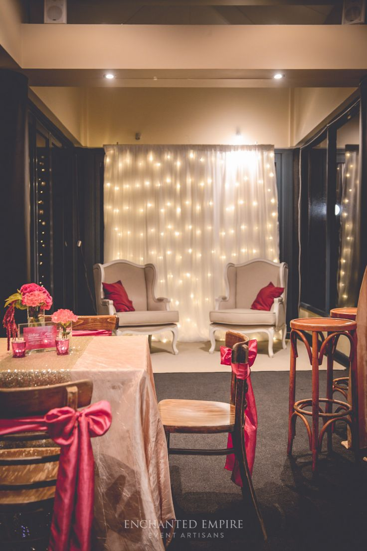 This cocktail wedding was adorned with twinkling fairy lights draped walls to create a beautiful atmosphere that attendees could feel transported into an intimate and romantic space. Bright florals were accented by the sparkling sequin runner details with a touch of rustic bentwood chairs to keep the theme fun whilst complimenting the decor seamlessly. Pink Wedding / Wedding Fairylights / Chartreuse Wedding / Champagne Wedding / Gold Wedding / Wedding Flowers www.enchantedempire.com.au
