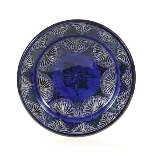 This hand painted decorative plate is a beautiful example of Moroccan ceramics. This Moroccan ceramic plate will add Moroccan decor and Mediterranean decor to your home. All our decorative plates are lead-free, and make lovely decorative wall plates.