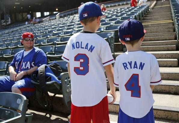 Chase Rice looks on as he is sons Nolan and Ryan Rice show their jerseys off before Game 4 of the ALDS between the Texas Rangers and the Toronto Blue Jays at Globe Life Park in Arlington, Texas on Monday, October 12, 2015. (Louis DeLuca/The Dallas Morning News)