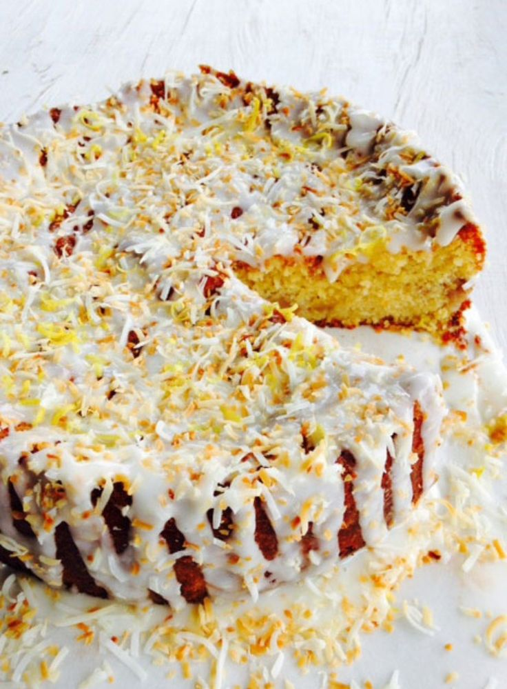 I've reworked an old favourite to make it gluten-free and also tweaked the ingredients a bit – now it's even more fabulous. With lots of fruit, a crown of lemon icing and toasted coconut, it's a big treat to share with friends.