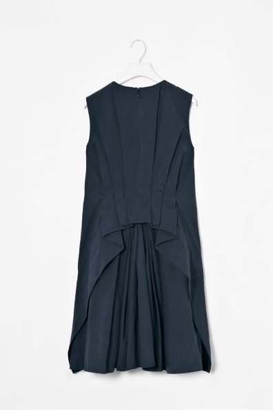Cos Pleated back dress - cotton, high pleated neckline and dramatic back layer with pleat detail for a ruffle effect. A loose A-line shape, side seam pockets and hidden back zip fastening.