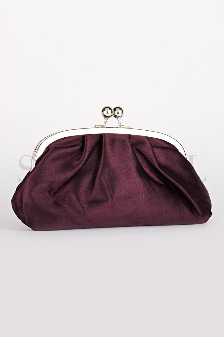 You can't finish off your old look just by flipping over the clothes on your body. Extra accessories add into your looks and make you more sizzling. How about a clutch? This maroon colored clutch defines style and class in a precise way. Carry it with a black saree and get all eyes set on you!