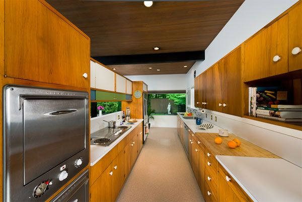 Kitchen... wood tone cabinets with white knobs.