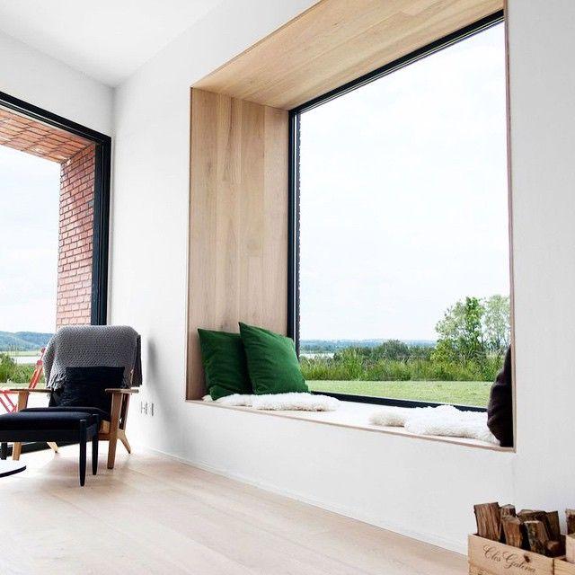 A modern nook is made cozy with plush kelly green pillows and sheepskin throws.   #AskPlaidFox #modern #homedecor #interiordesign #design #interiors #home #house #livingroom #chair #nook #design
