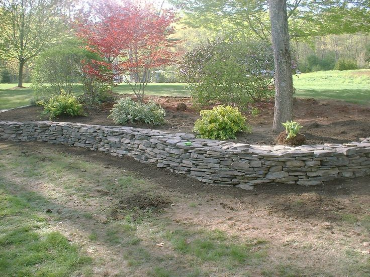 stone retaining walls natural stone retaining wall and. Black Bedroom Furniture Sets. Home Design Ideas