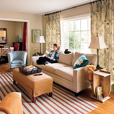 neutral living rooms. Couch in front of window.
