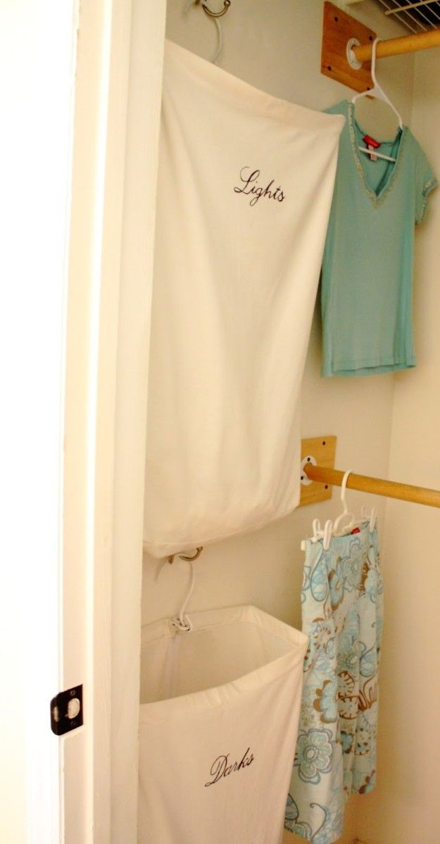 Organize your laundry hampers vertically to save space in a small home or apartment.