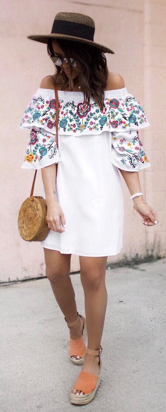 Embroidered off the shoulder dress.