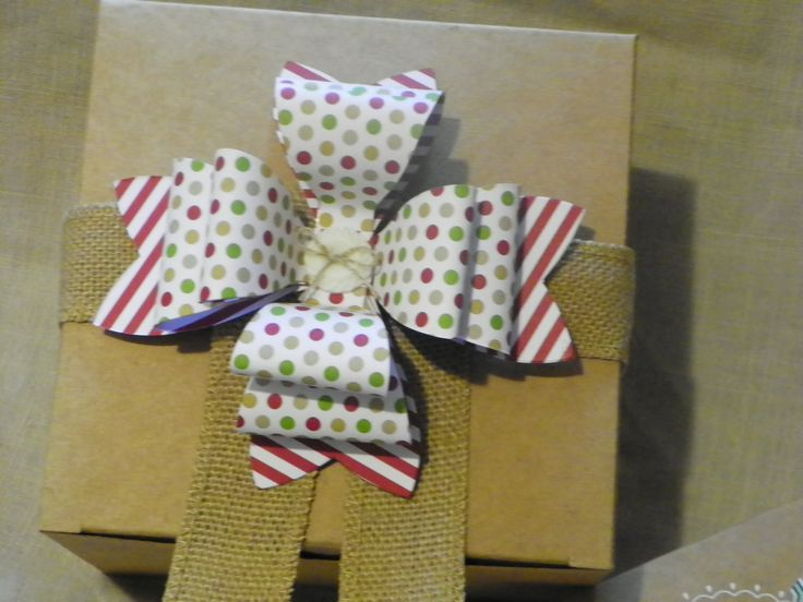 Using burlap ribbon and a double dose of the Stampin Up gift bow biz die makes a gift special!  By Erin Cook