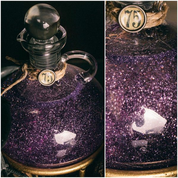 DIY Harry Potter Potions for Halloween: Potion 75 Fine glitter suspended in corn syrup, stopper glued on with E600. Twine and Halloween sticker finish the look