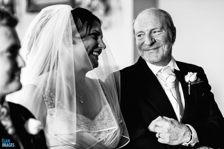 The Brides father letting go of her hand during a wedding ceremony at Orchardleigh House in Somerset