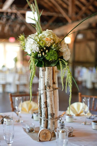 A tall rustic centerpiece with some drama! Love the use of birch tree branches wrapped in twine. {@danifinephoto}