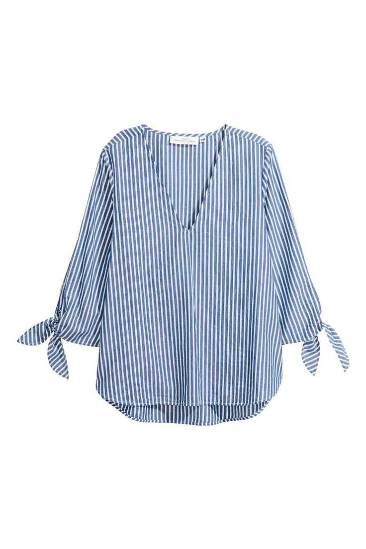 Striped blouse: Wide blouse in an airy, striped cotton weave with a deep V-neck, 3/4-length sleeves with ties at the cuffs and a rounded hem. Slightly longer at the back.