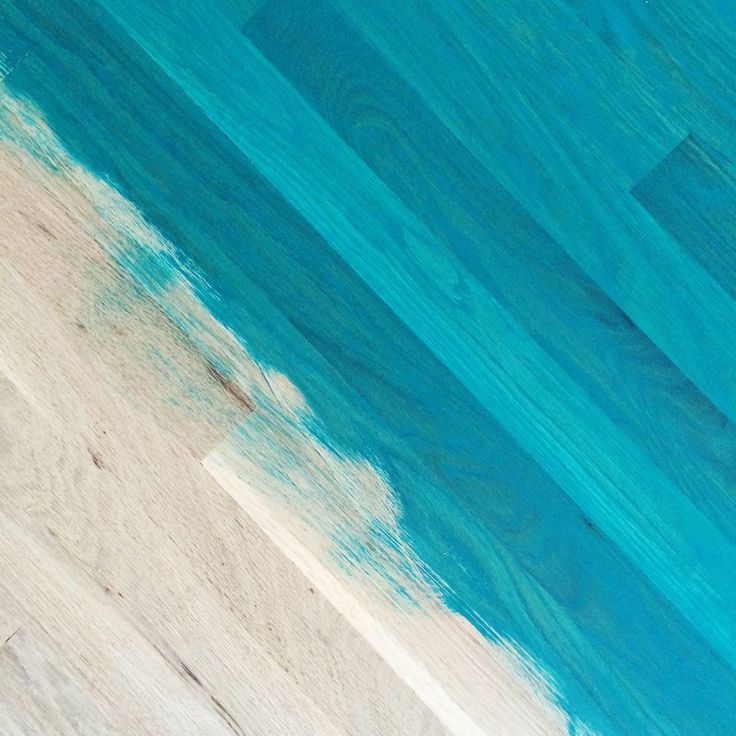 DIY:  How to Stain Wood Floors, using Paint - unhappy with the stain choices available, this blogger mixed her favorite paint color with water to get this awesome look - via A Beautiful Mess