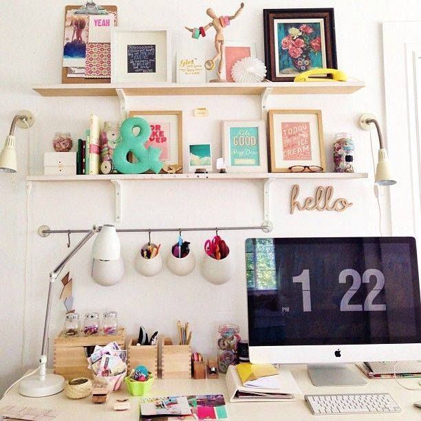 Cute, feminine home office styling. Love the framed art prints.