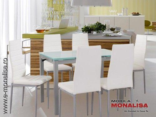Set MeseLiving extensibile Sticla alba cu 6 scaune  Oferta cuprinde o masa moderna cu blat alb fabricat din sticlasablata si pachet de 6 scaune albe tapitate. Masa cu scaune albe Next este recomandata in amenajarea moderna a zonei de living,bucatarie sau dining.  Atunci cand vorbim de promotii mese si scaune trebuie sa tinem cont atat de pret dar si de calitatea produselor din promotie.  Masa extensibila Next ofera un blat rezistent cu dimensiuni generoase sustinut pe un cadru…