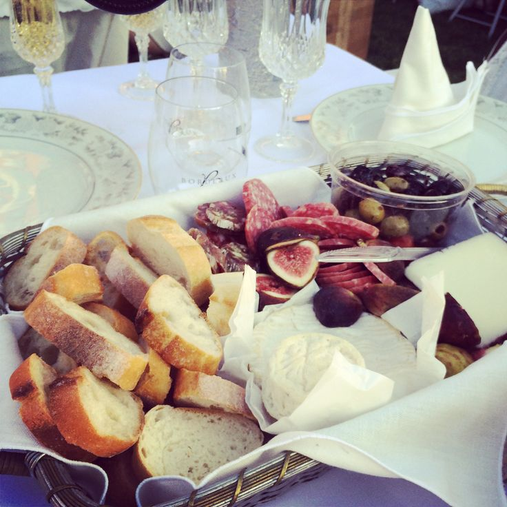 Diner en Blanc food ideas: White basket every 8-10 people filled with breads, nuts, olives, smoked fish, cheese and dried fruits. Charcuterie, too